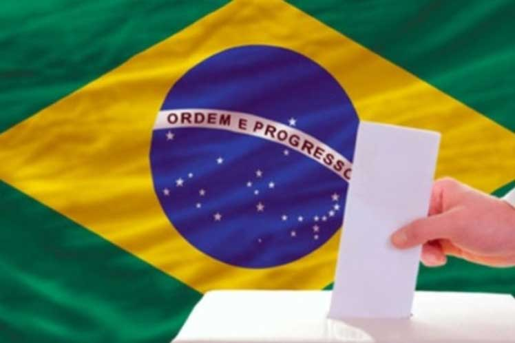 Far-right candidate wins first round of Brazil election