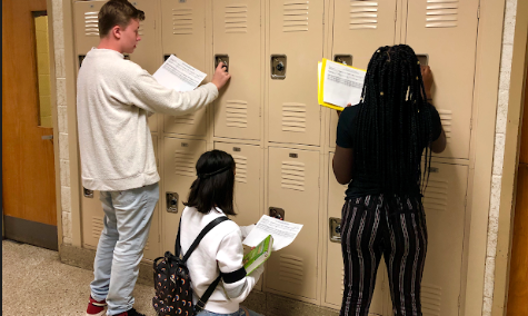 Excited JFKMHS students at their lockers with their schedules in-hand.