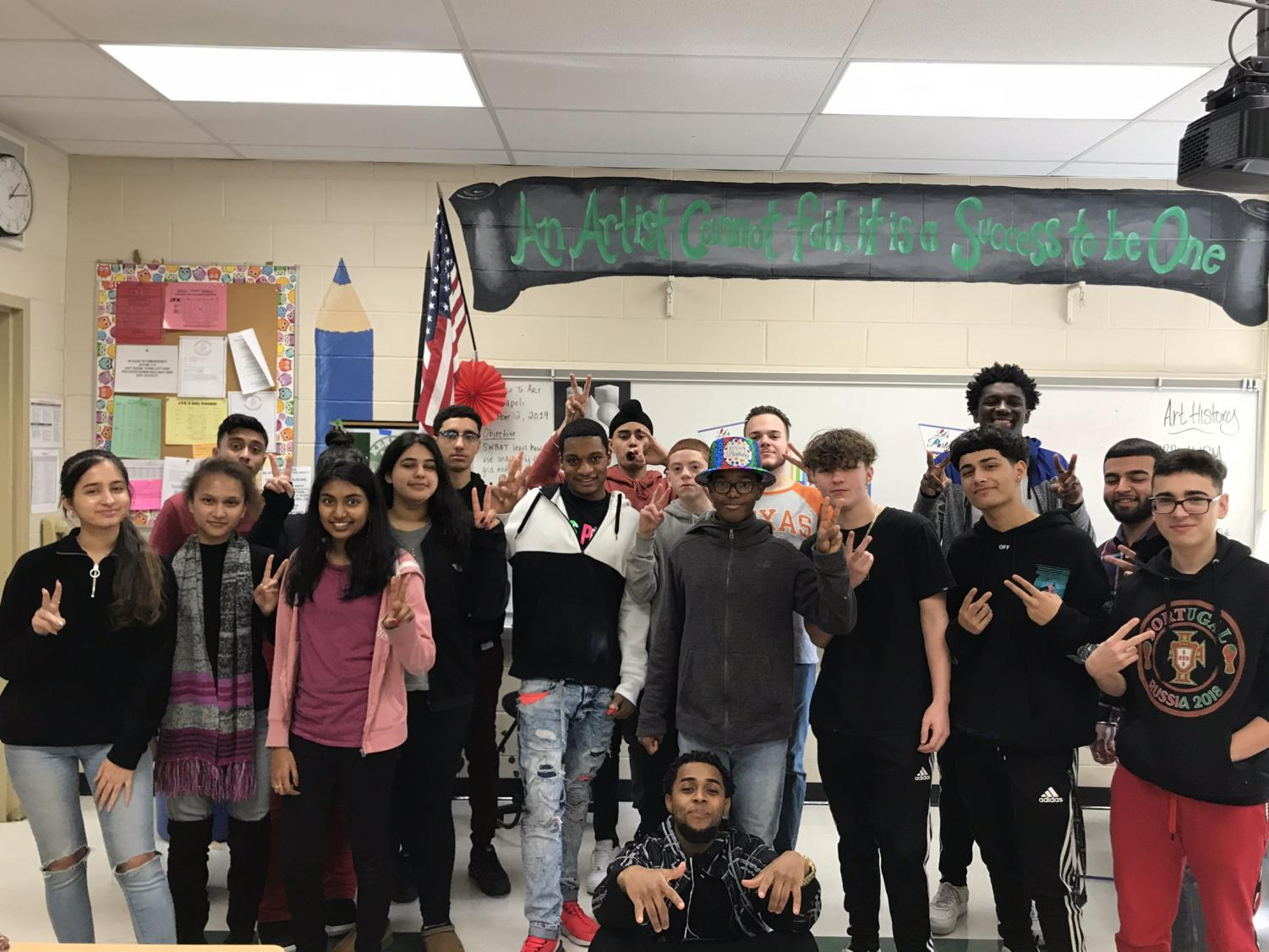 The fourth block Advancing with Apple Class stands with David, their classmate, during his surprise birthday party