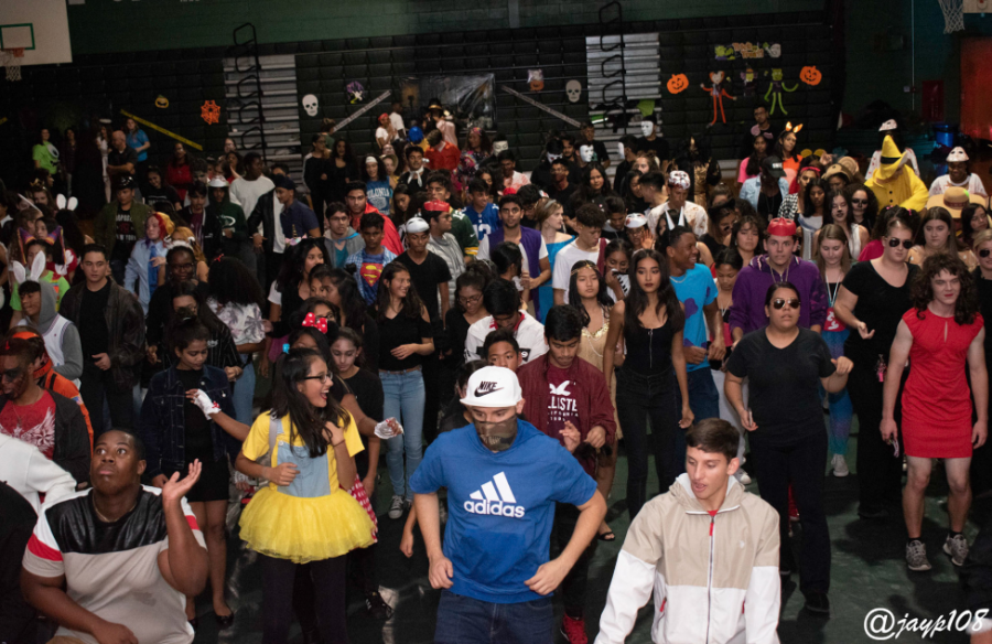 A crowd of students dance at the 2019 masquerade.  But did less students attend this year than previous years?
