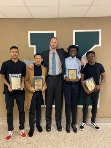 Coach DeVoogd poses with Vishal Patel, Nadir Cassiem, Papa Asmah, and Ayman Pitts as they hold their awards