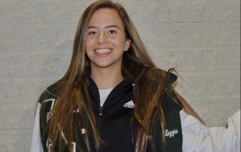 Here is an image of Elizabeth Klimek in her varsity jacket near an Applebees