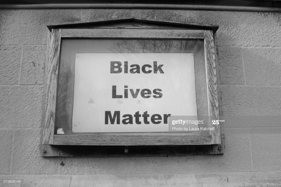 In NYC, a Black Lives Matter sign is posted where a schedule used to be. Photo Credit: Photo via Getty Images under the creative commons license.