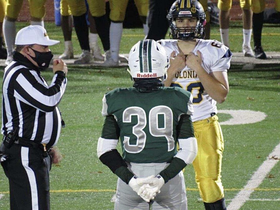 Photo 1: Courtesy to Dawn Hein. Senior Captian Michael Hein and the Captain of the Colonia Patriots preparing for the coin toss for overtime.