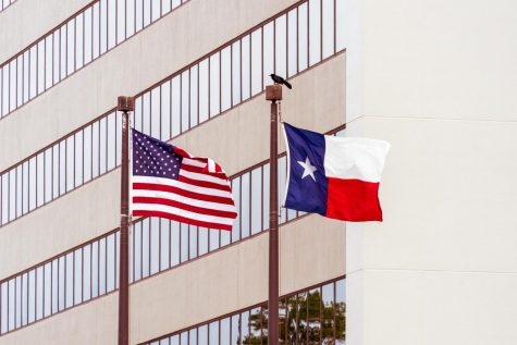 Photo of the Texas flag next to the American flag.  Photo Credit: Photo via unsplash under the creative commons license.